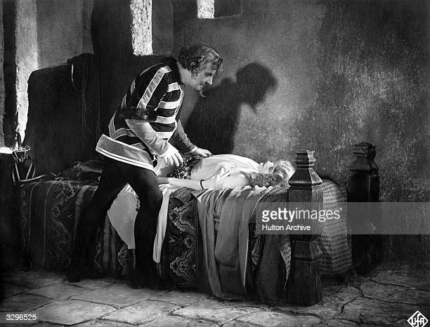 A scene from the film 'Der Nachte' where a man hovering over the bed of a sleeping woman throws a macabre shadow