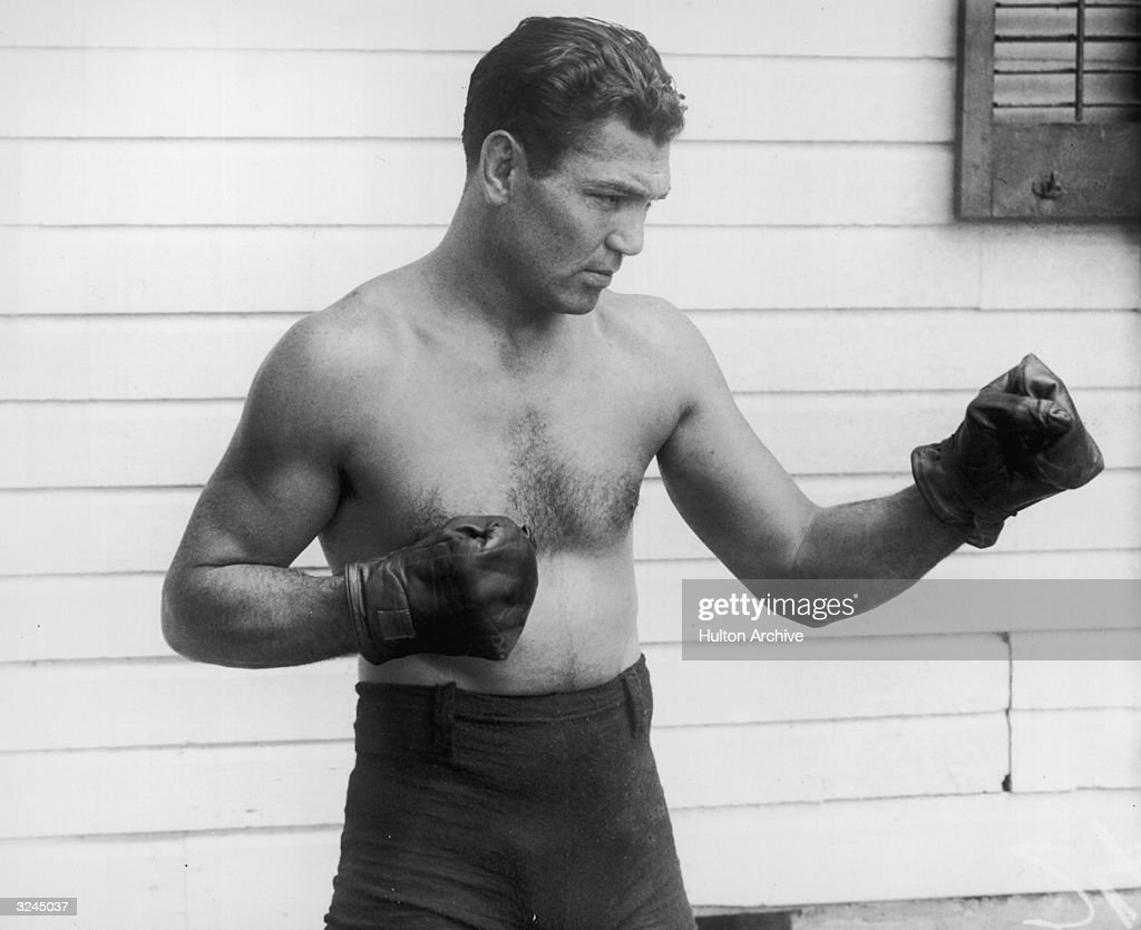American boxer <a gi-track='captionPersonalityLinkClicked' href=/galleries/search?phrase=Jack+Dempsey+-+Boxer&family=editorial&specificpeople=15348667 ng-click='$event.stopPropagation()'>Jack Dempsey</a> (1895 - 1983) poses outdoors in a fighting stance. He wears boxing trunks and gloves.