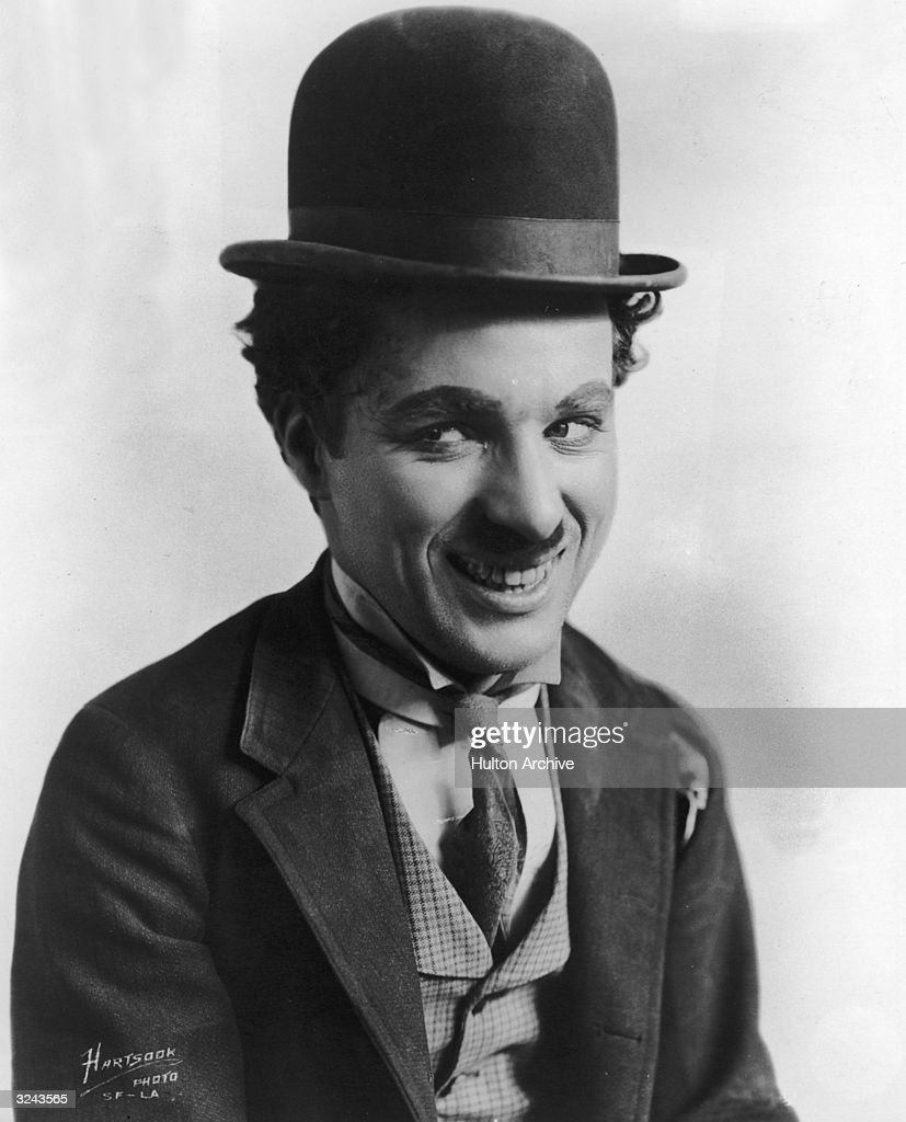 British comic actor and film director Charles Chaplin (1889 - 1977) in character as the Little Tramp.