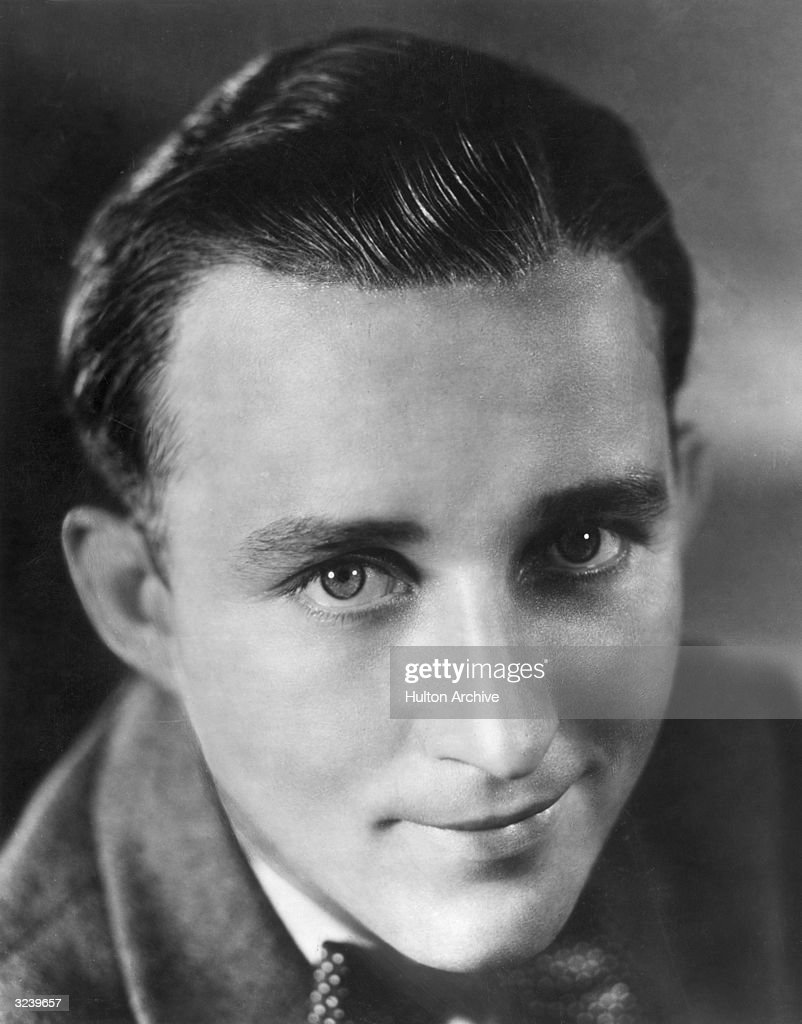Closeup portrait of American singer and actor <a gi-track='captionPersonalityLinkClicked' href=/galleries/search?phrase=Bing+Crosby&family=editorial&specificpeople=90412 ng-click='$event.stopPropagation()'>Bing Crosby</a> smiling, wearing a jacket and a bow tie.