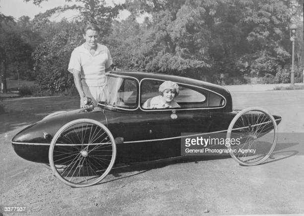 Dr Manfred Curry standing beside his invention the CurryLandskiff a manpowered vehicle which can reach speed of up to 35 miles per hour