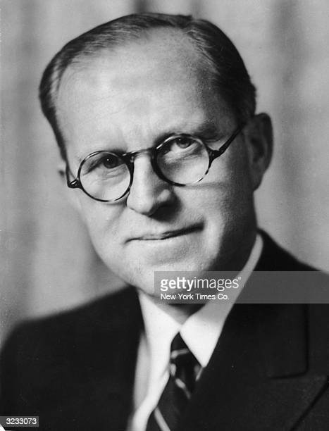 Headshot portrait of American businessman and diplomat Joseph P Kennedy wearing eyeglasses and smiling Joseph was father of US President John F...