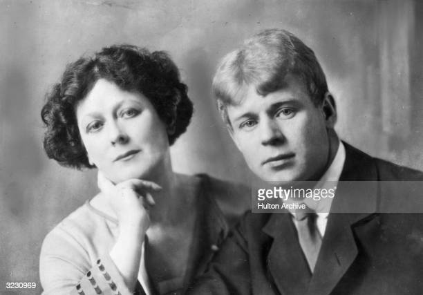 Headshot studio portrait of American dancer Isadora Duncan and her husband Russian poet Sergei Yesenin posing indoors