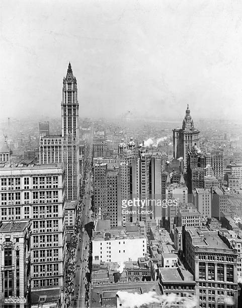 High angle view looking north of skyscrapers and traffic on Broadway in downtown Manhattan with the Municipal Building and the Woolworth Building New...