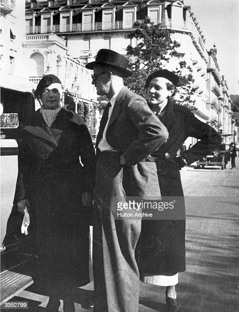 Irish writer James Joyce with his wife Nora left and Mrs C Fredion