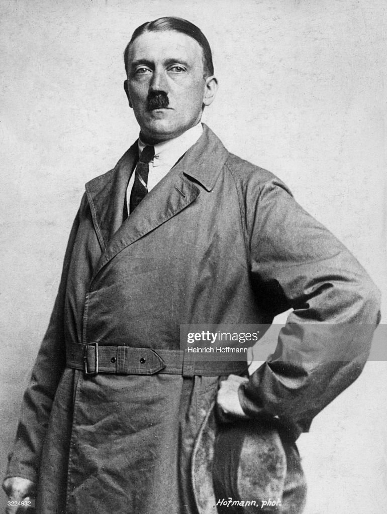 Studio portrait of dictator and leader of the German Nazi movement Adolf Hitler posing with his hand on his hip in an overcoat and a shirt and tie