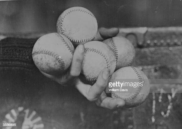 Tiny Osborne of the Brooklyn Dodgers demonstrates his unique ability to hold five baseballs in one hand