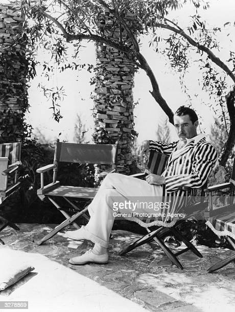 John Gilbert the US film star at home in his garden