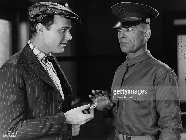 Lon Chaney with William Haines in a scene from the film 'Tell It To The Marines' directed by George Hill