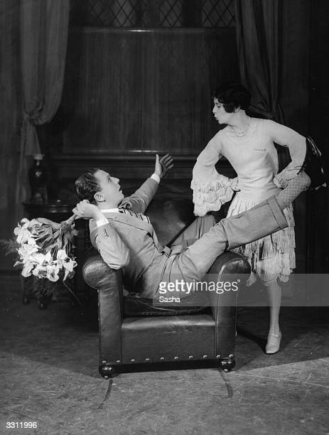 Real life husband and wife team Arthur Maryetson and Vera Lennox in a scene from `Just A Kiss' at the Shaftesbury Theatre London