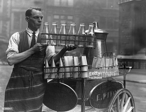 The advent of paper milk cartons was an important event for dairymen and delivery men Six bottles are contrasted with the cartons on this delivery...