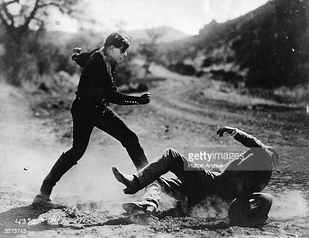 Jack Hoxie formerly Hartford Hoxie the American star of early westerns in a violent fighting scene from the film 'Western Whirlwind'