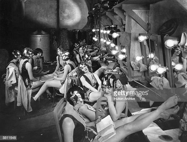 A dressing room full of chorus girls between scenes during the filming of 'Broadway'