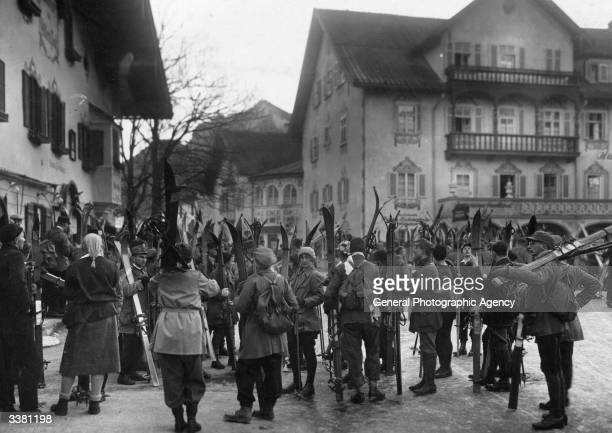 A group of tourists in Oberammergau waiting to go skiing in Bavaria