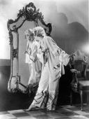 American actress and MGM player Bessie Love admiring herself in a mirror