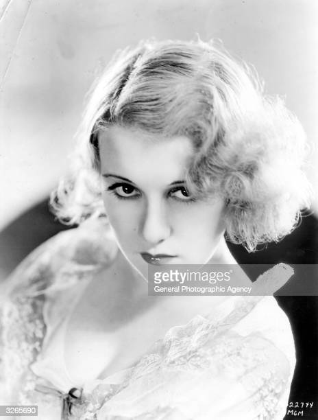 Anita Page the beautiful film actress sporting a new hairstyle especially created to suit her feminine personality with a fluffy faceframing style...
