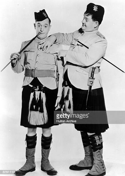 Comic duo Stan Laurel and Oliver Hardy in Highland attire