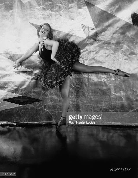 Film star Joan Crawford poses enpoint in a ballerina's tutu