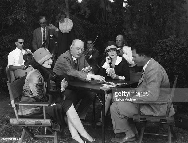 Hollywood director King Vidor Jane Winton and actress Marion Davies learning the art of bridge from Milton G York the international player
