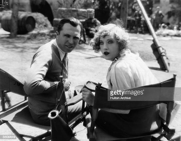 Hollywood director King Vidor sitting with actress Marion Davies during location filming of their latest collaboration the MGM film 'Show People'