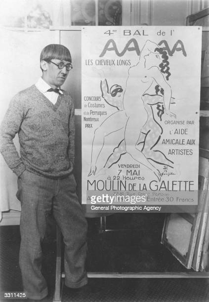 Japanese artist Tsuguharu Foujita with one of his works a poster advertising a dance in Paris