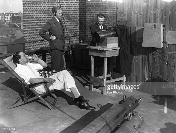 Scottish stage and film actor Jack Buchanan on the roof of the Television Company's offices with Scottish electrical engineer and television pioneer...