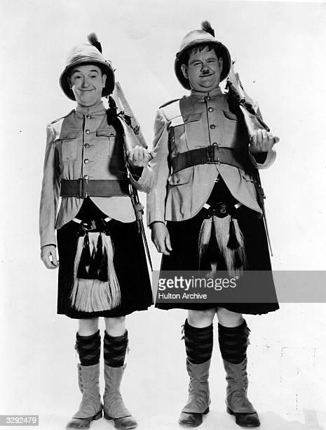 Stan Laurel originally Arthur Stanley Jefferson and Oliver Hardy wearing Scottish military uniforms