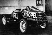 The fastest car in the world an Opel driven by 24 rockets situated in its tail end Designed by Herr Fritz von Opel and first driven in Berlin