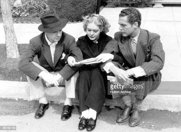 Twentieth Century Fox players Jack Haley Alice Faye and Michael Walen reading their fan mail