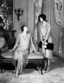 Two elegant women engaged in conversation in a scene from the Strand Theatre's production of 'Beauty'