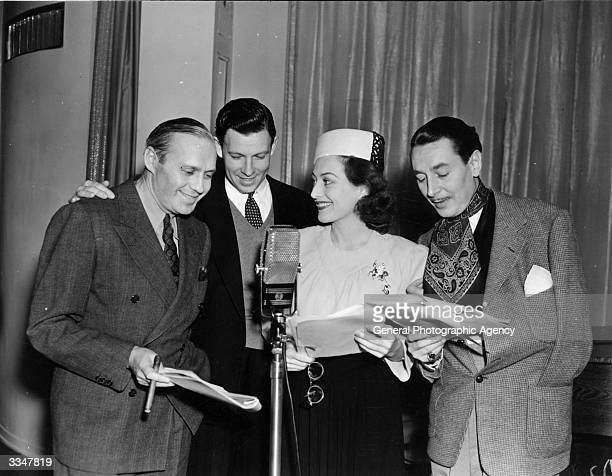 A group of stars broadcasting a radio porgramme Left to right Jack Benny actor dancer and politician George Murphy Joan Crawford and Reginald Gardiner