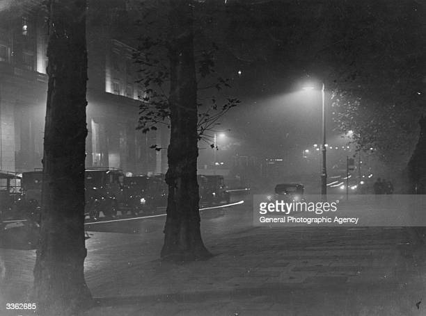 A lone car in a street in Piccadilly London at night