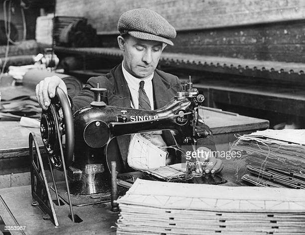 A man operating a sewing machine in a factory