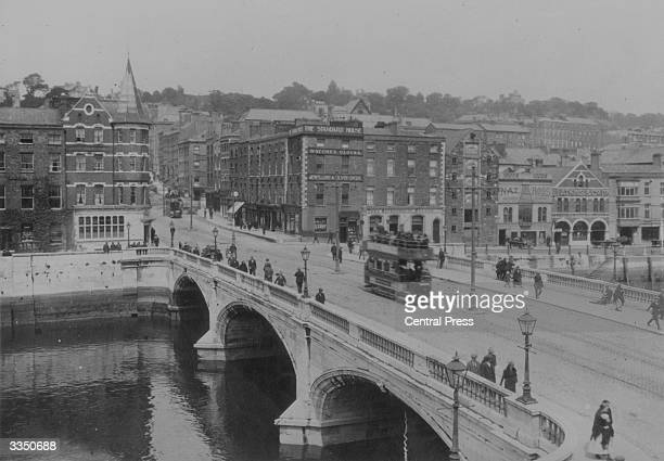A tram crosses the bridge in Cork City Ireland