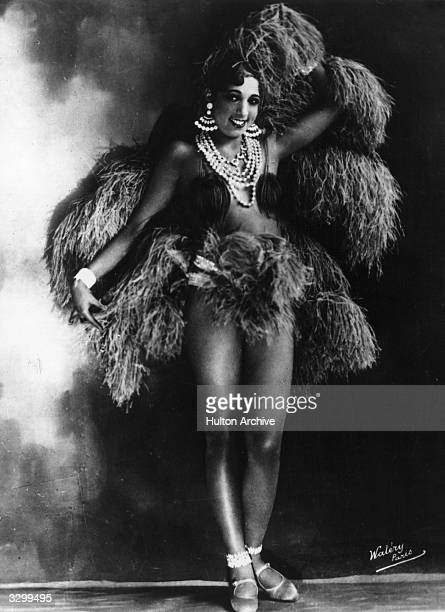 American singer and exotic dancer Josephine Baker of the Parisian Folies Bergere poses in one of her many elaborate costumes