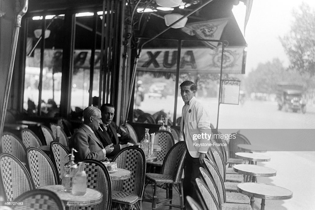 composer <a gi-track='captionPersonalityLinkClicked' href=/galleries/search?phrase=Maurice+Ravel&family=editorial&specificpeople=488980 ng-click='$event.stopPropagation()'>Maurice Ravel</a> at a cafe terrace, circa 1930, in Paris, France.