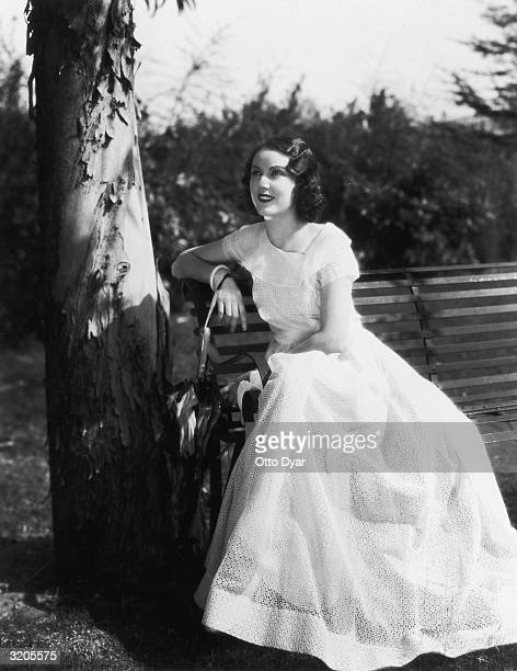 Hollywood film star Fay Wray wearing a fulllength summer dress