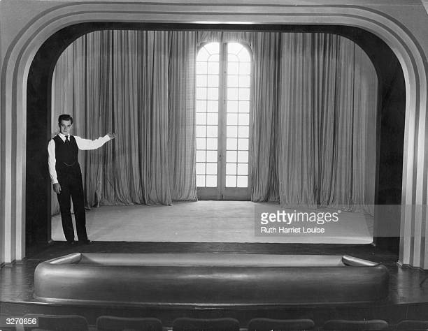 Metro Goldwyn Mayer actor Ramon Novarro on the stage of his private theatre at his Hollywood home It seats 65 and has every modern device for...