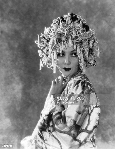 Mexican actress Dolores Del Rio formerly Dolores Asunsolo wife of the MGM art director Cedric Gibbons wearing an amazing headdress