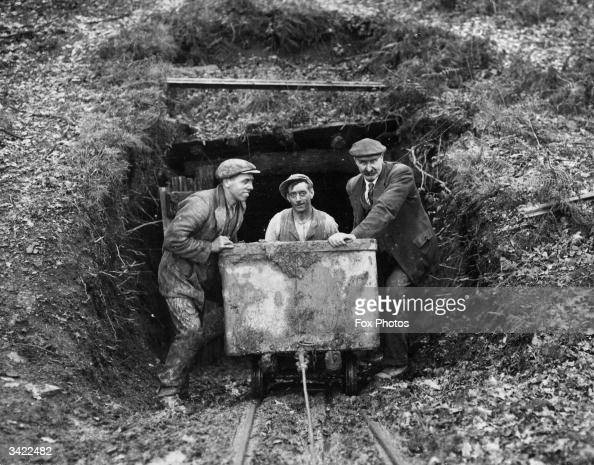 Miners bring out coal out from a small privately owned mine in the Forest of Dean