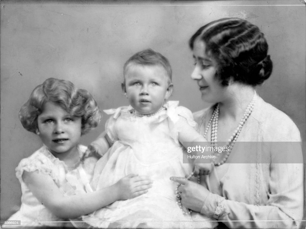 Queen Elizabeth, Queen Consort to King George VI with Princesses Elizabeth (left) and Margaret Rose (1930 - 2002).