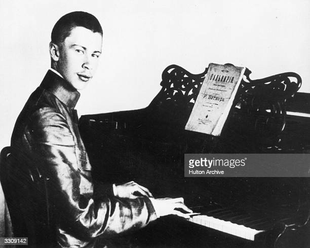 Russian composer Sergey Sergeyevich Prokofiev at the piano with a score of Wager's 'Die Walkure'