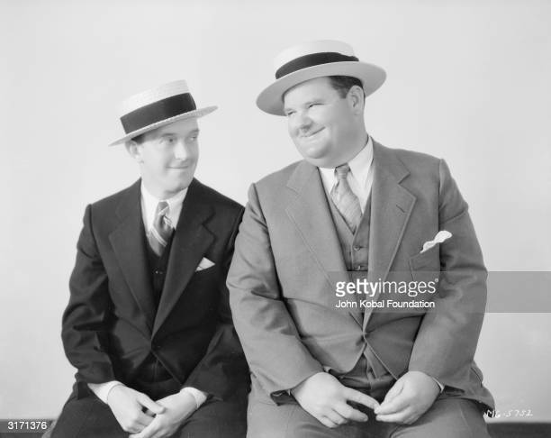 Stan Laurel and Oliver Hardy wearing straw boaters instead of their trademark bowler hats