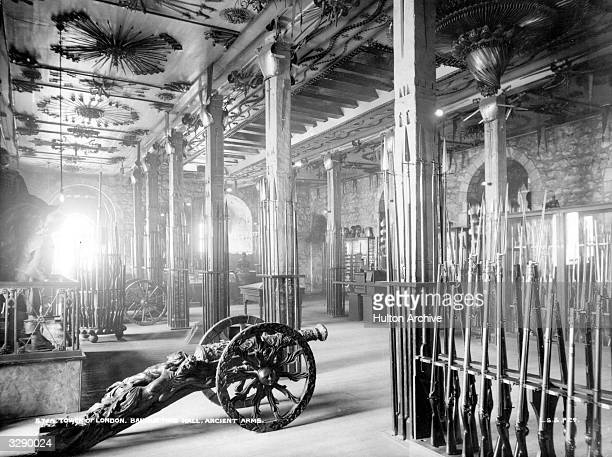 The Armoury in the Tower of London where ancient arms are on display The Tower a fortress on the River Thames has been used as a palace a main state...