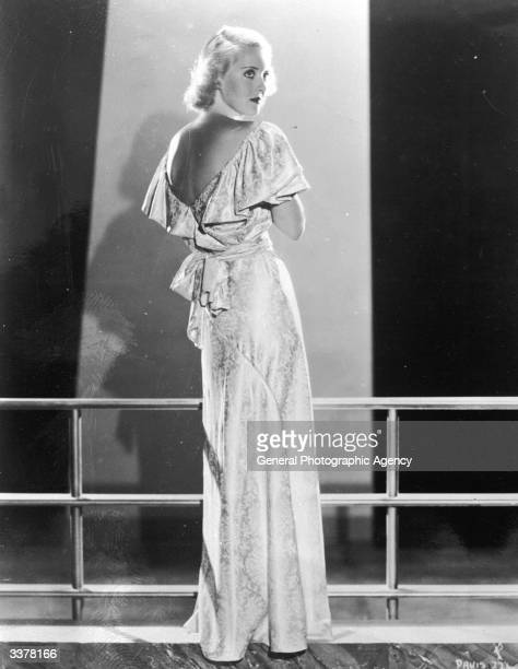US actress Bette Davis wearing an evening dress