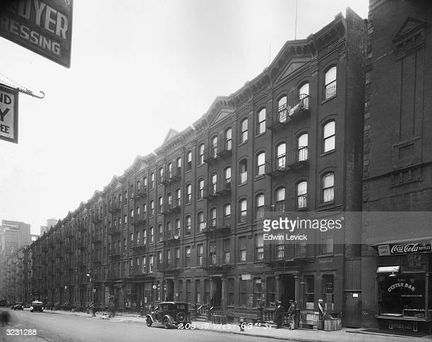 View of row house apartment buildings from 20319 West 63rd Street in New York City An oyster bar occupies a storefront