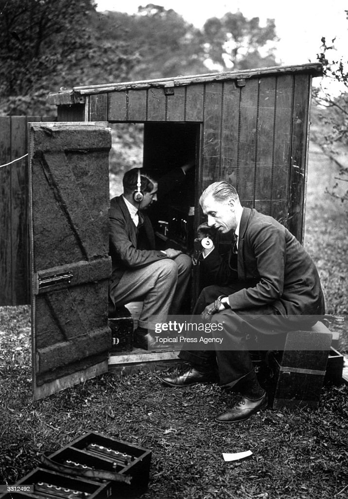 Engineer Mr Loyd sitting in a hut in a wood in Berkshire, recording the song of a nightingale for the BBC.