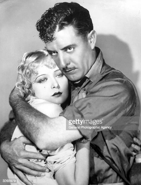 A still of John Gilbert and Mary Nolan for the flm 'Desert Lights'