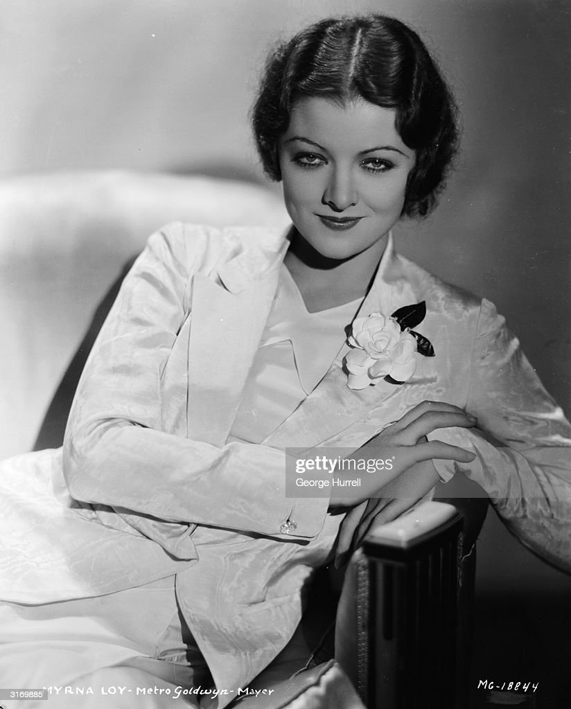 American actress <a gi-track='captionPersonalityLinkClicked' href=/galleries/search?phrase=Myrna+Loy&family=editorial&specificpeople=93857 ng-click='$event.stopPropagation()'>Myrna Loy</a> (1905 - 1993) wearing a suit with a rose in the lapel.