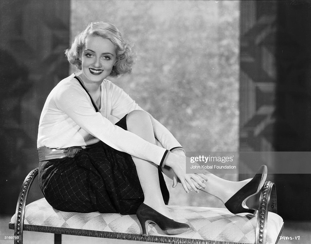 American film star <a gi-track='captionPersonalityLinkClicked' href=/galleries/search?phrase=Bette+Davis+-+Actress&family=editorial&specificpeople=93133 ng-click='$event.stopPropagation()'>Bette Davis</a> (1908 - 1989) wearing high heels and a winning smile.